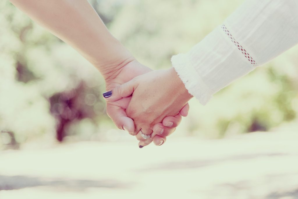 holding hands with spouse