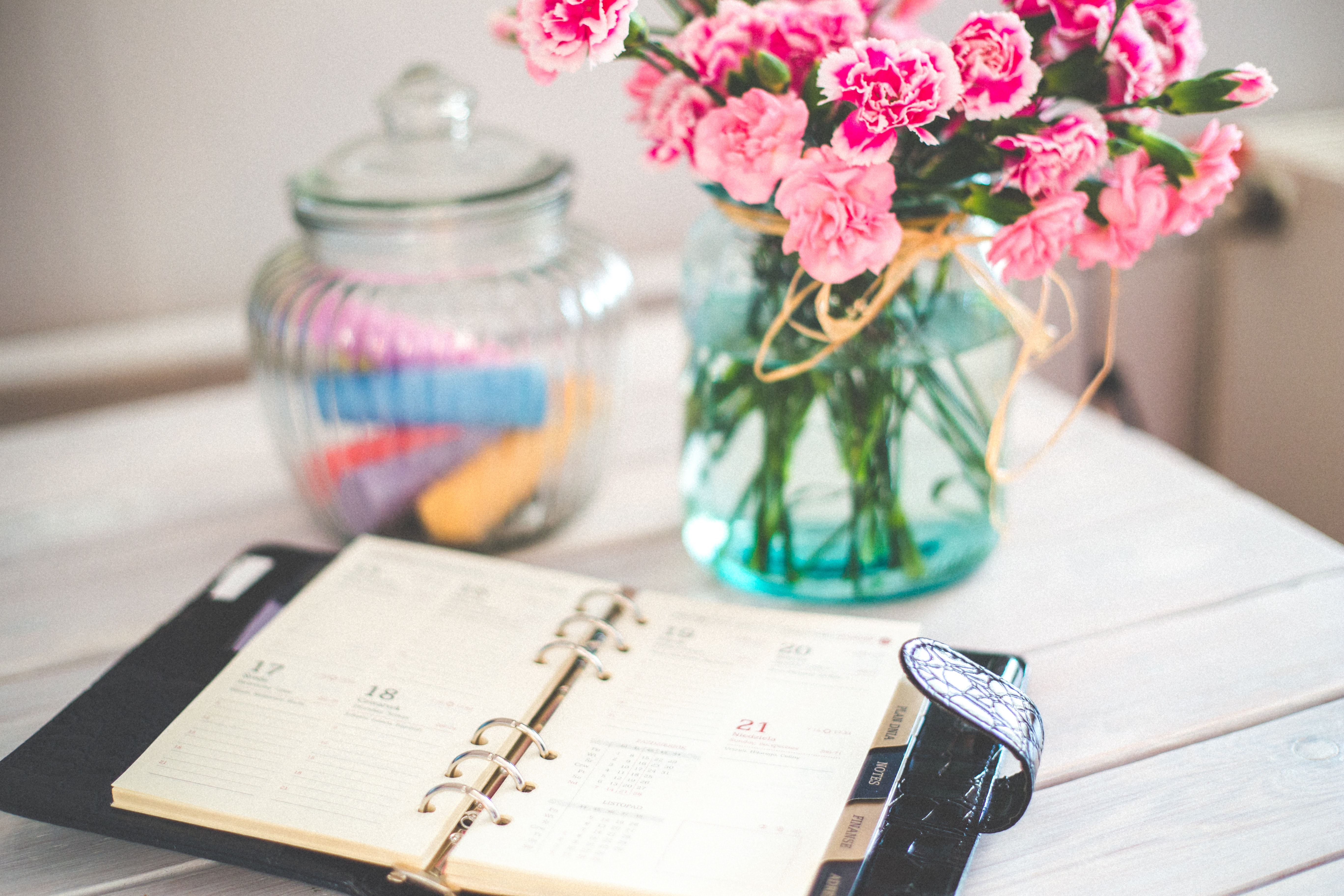 planner on a table with flowers