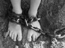 feet wrapped in chains