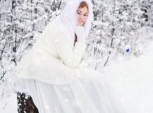 woman in white wedding dress in the woods