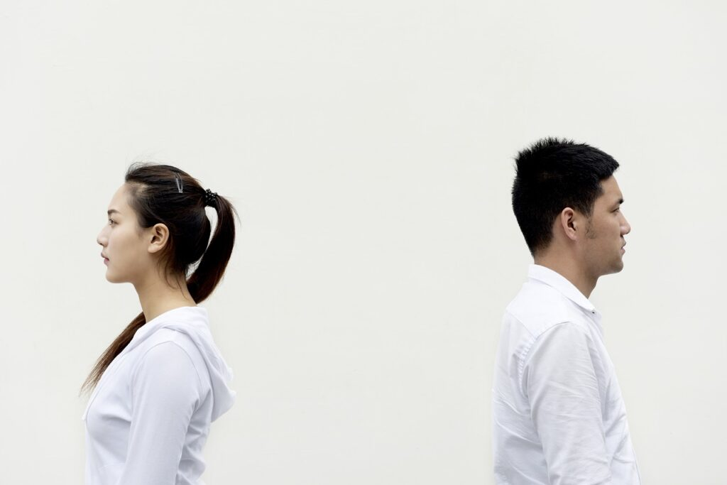 couple fighting and turning their back on each other needs couples counseling